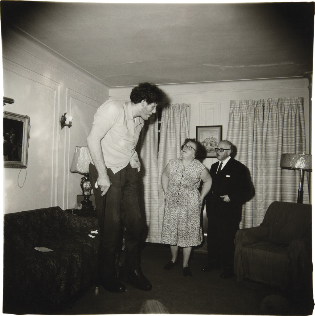 A Jewish giant at home with his parents in the Bronx, N.Y.