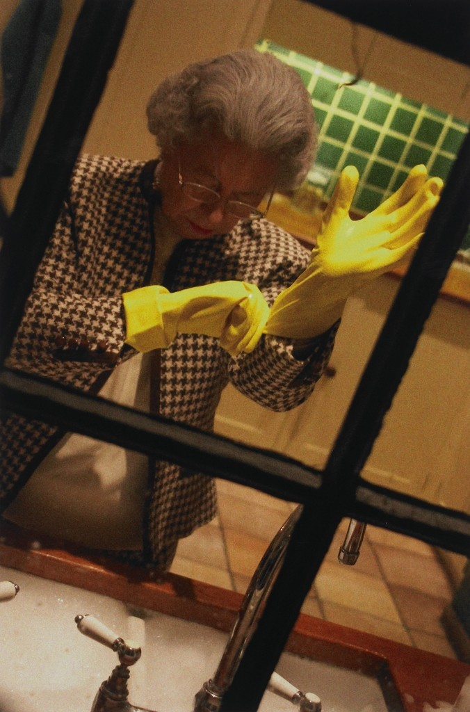 Queen in washing gloves at sink