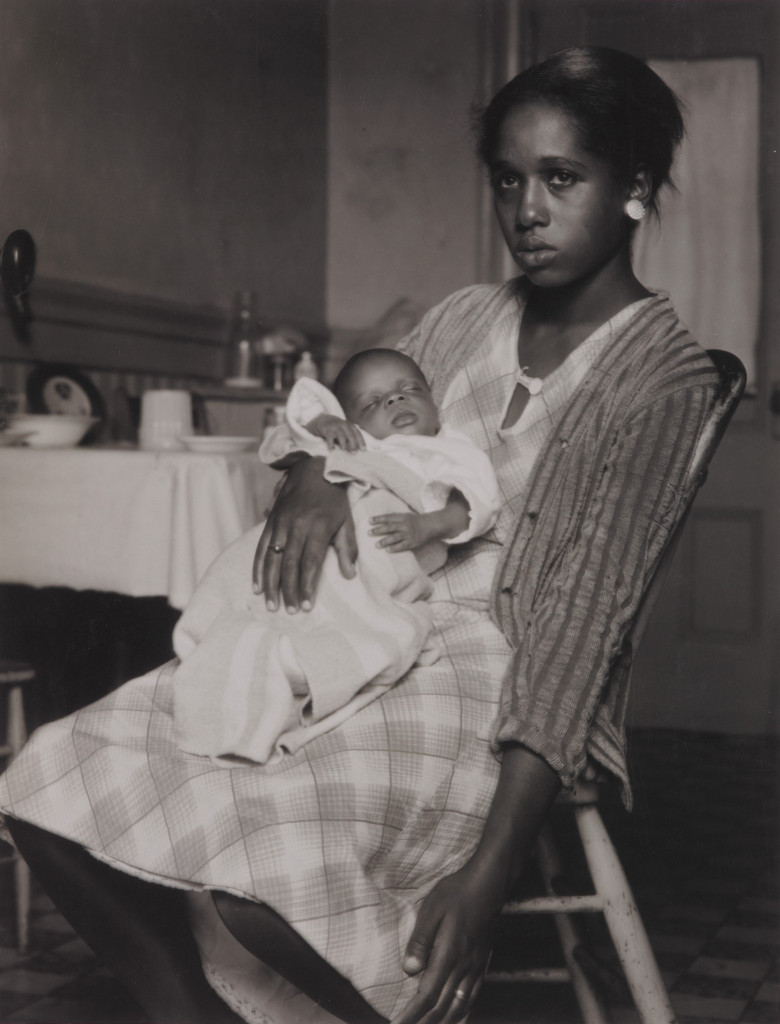 Young black woman with infant