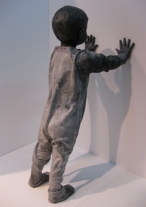 A child leaning on the wall
